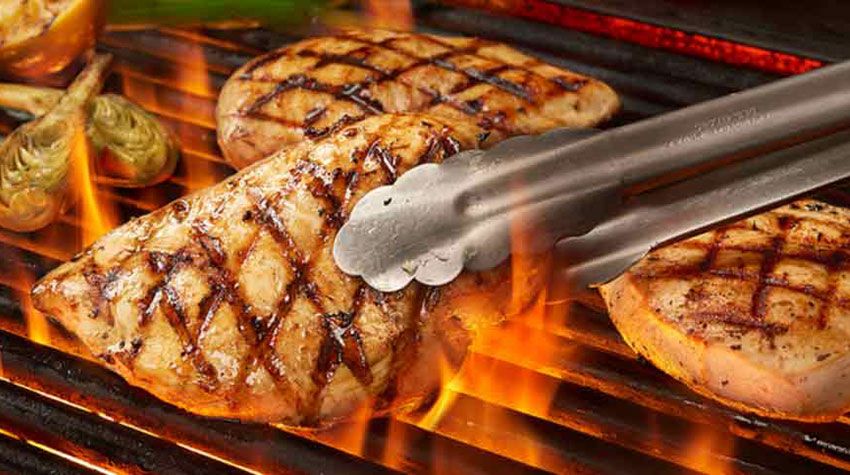 Perdue Harvestland Organic Skinless Chicken Breast being grilled